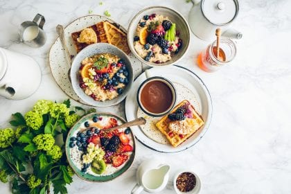 a meal on a table with lots of different bowls